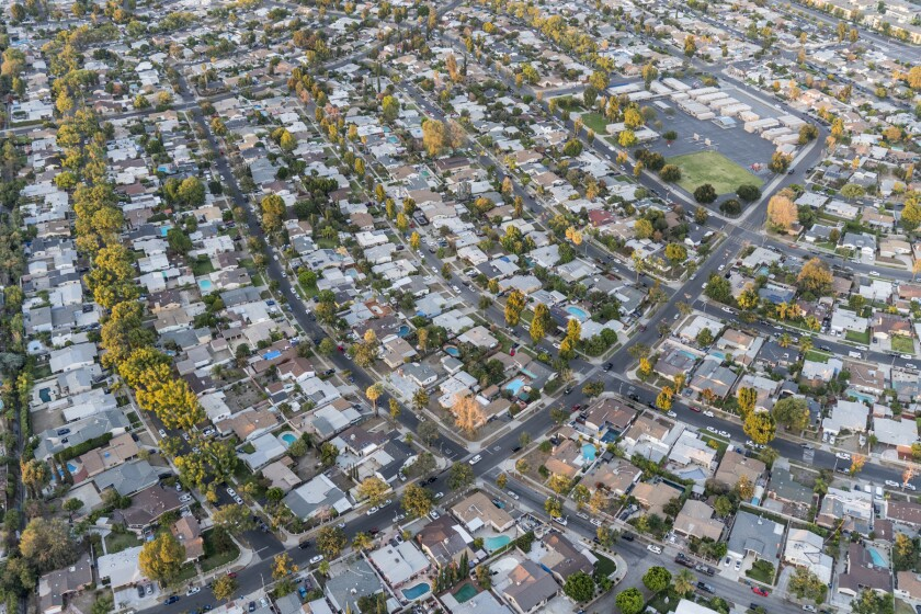 Late afternoon aerial view of houses and streets in the San Fern