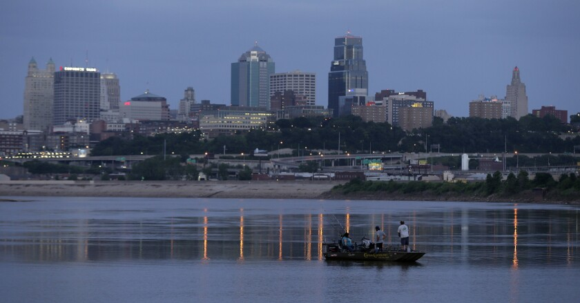 In this 2013 file photo, people fish in the Missouri River along the banks of downtown Kansas City, Mo. Amazon's final cut of 20 contenders for its second headquarters leaves hundreds of cities disappointed. That includes hopefuls like Detroit and Kansas City, Mo.