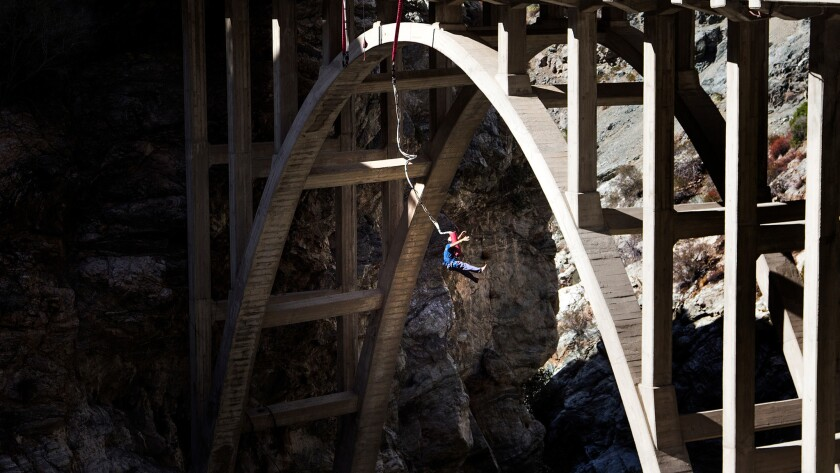 A bungee jumper dangles over the San Gabriel River after doing a backward plunge off the Bridge To Nowhere.