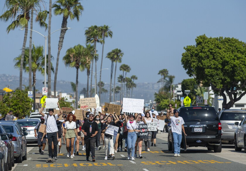 Protesters walk along Balboa Boulevard in Newport Beach during a peaceful protest June 3 over the killing of George Floyd.