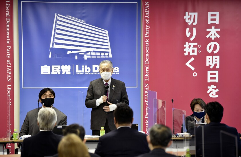 Tokyo Olympic and Paralympic Games Organising Committee President Yoshiro Mori, center, delivers a speech at a beginning of a meeting on the preparation for the Tokyo Olympics and Paralympics at the Liberal Democratic Party (LDP) headquarters in Tokyo Tuesday, Feb. 2, 2021. (Kazuhiro Nogi/Pool Photo via AP)