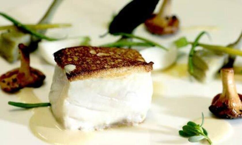 Alaskan halibut with artichoke, mushroom and mustard is $22 at Eva.