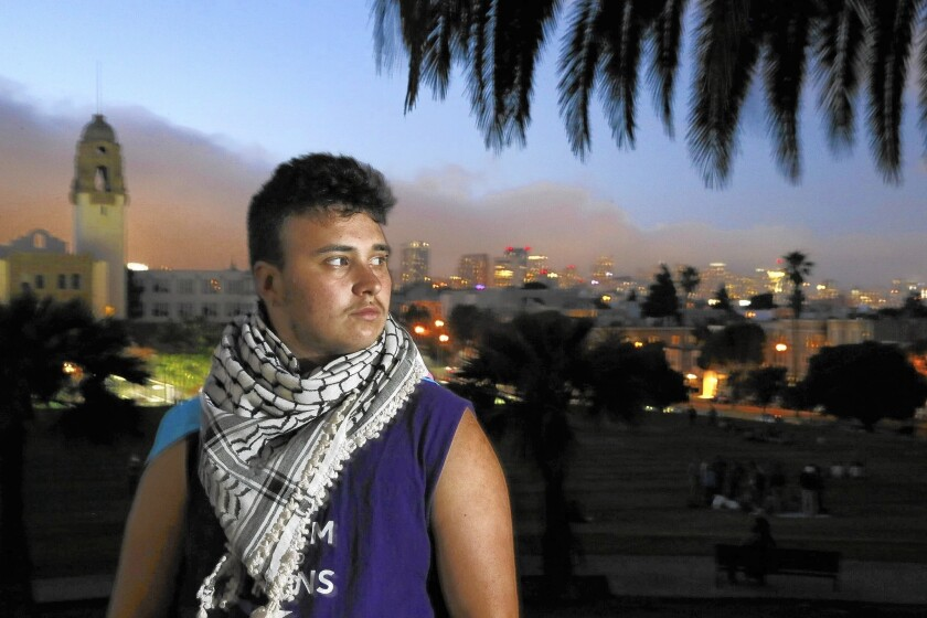 Alex Bergeron wears his father's kaffiyeh around his neck in San Francisco.