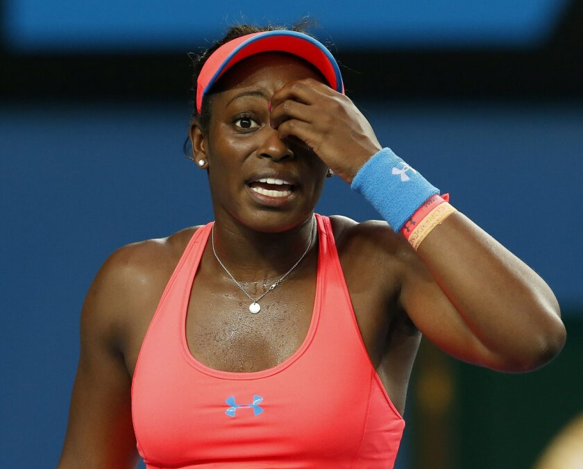 Sloane Stephens of the U.S. reacts during her second round match against Ajla Tomljanovic of Croatia at the Australian Open tennis championship in Melbourne, Australia, Thursday, Jan. 16, 2014.(AP Photo/Eugene Hoshiko)
