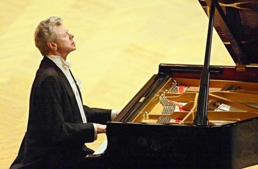 Van Cliburn performs at a 2004 concert dedicated to the memory of the victims of the Beslan school massacre in Moscow.