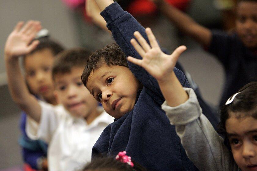 Kindergartners focus on reading one recent morning at Barrio Logan's Perkins Elementary School.