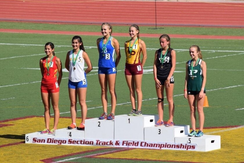 Torrey Pines High School senior Jackie Garner atop the San Diego CIF Championships victory stand for the 3200 meters.