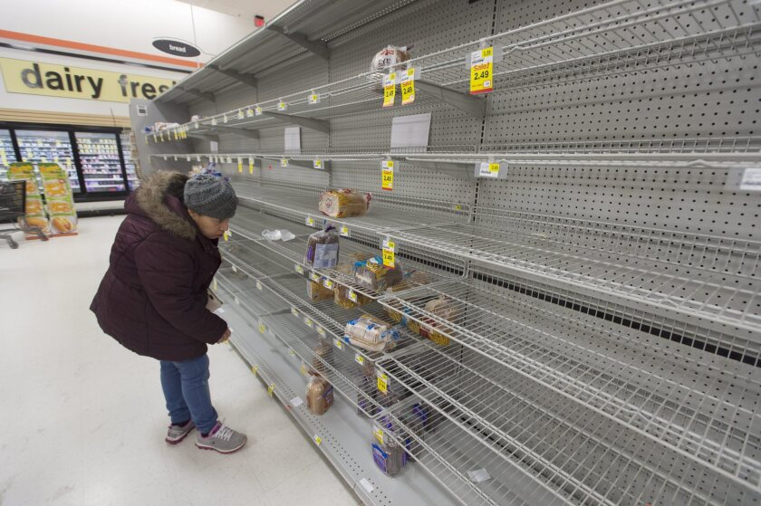 Shelves were mostly empty in this Alexandria, Va., grocery store a day before the storm.