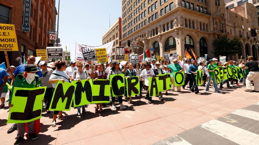 LOS ANGELES, CA - MAY 1, 2017 -Marchers carry letters that spell out Immigration Reform Now while ma
