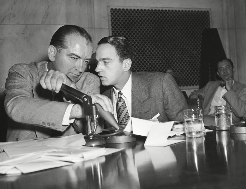 "Sen. Joseph McCarthy and Roy Cohn confer in ""Where's My Roy Cohn?"""