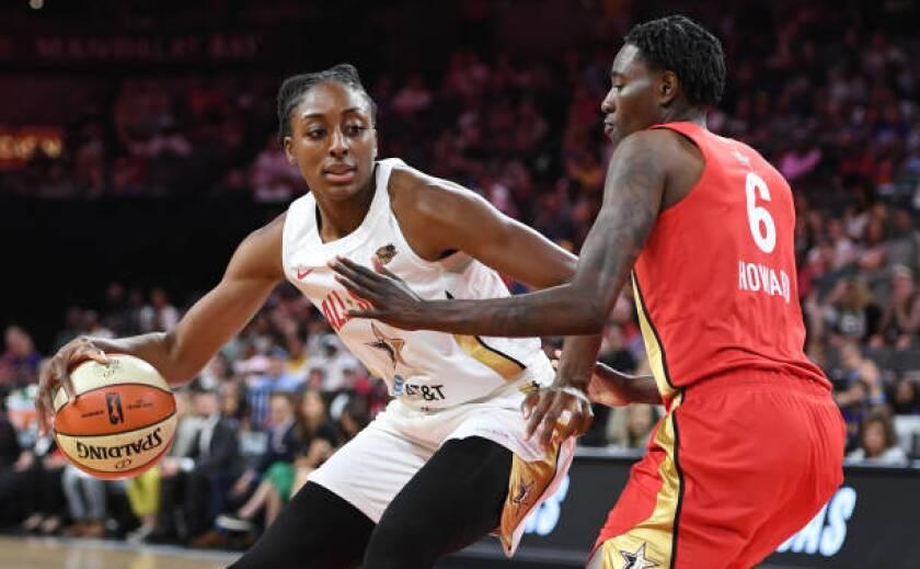 Sparks forward Nneka Ogwumike drives against Seattle Storm forward Natasha Howard.