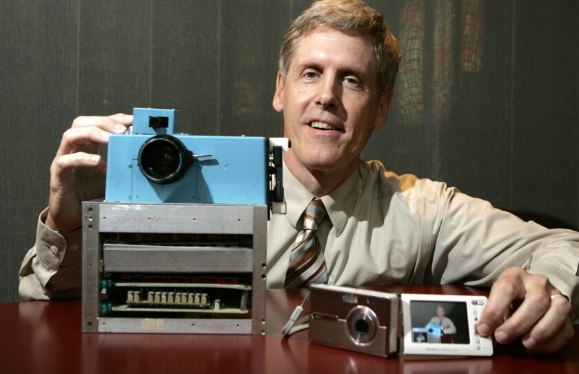 In this Aug. 17, 2005 file photo, Steven J. Sasson, then an Eastman Kodak project manager, shows a prototype digital camera he built in 1975 next to Kodak's latest digital camera the EasyShare One, at the company's headquarters in Rochester, N.Y.