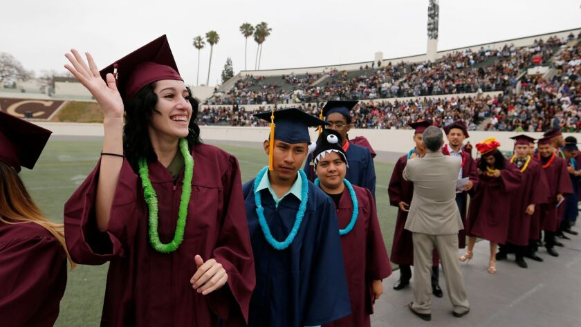 More L.A. Unified students, like Metropolitan High School's Yesenia Ceballos, 18, left, graduated this year, but a persisting challenge is to get them to graduate from college.