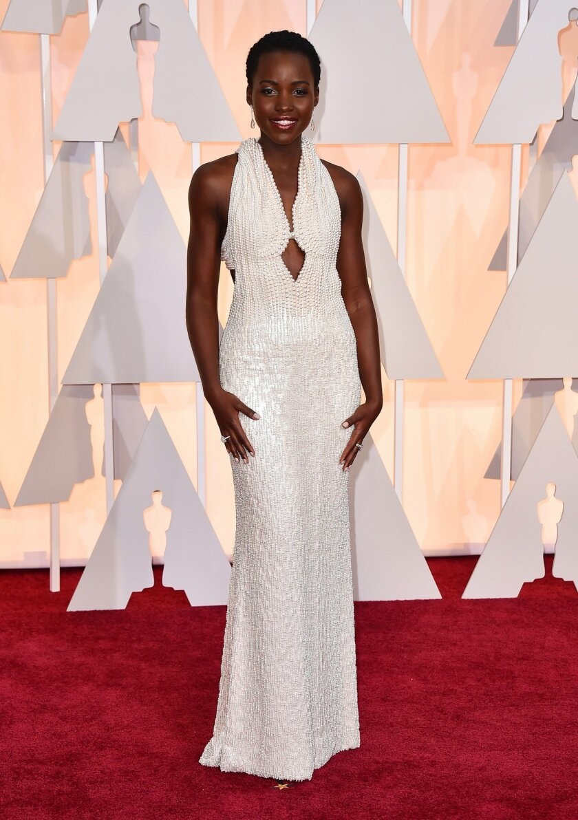 Lupita Nyong'o arrives at the Oscars on Sunday, Feb. 22, 2015, at the Dolby Theatre in Los Angeles. (Photo by Jordan Strauss/Invision/AP)