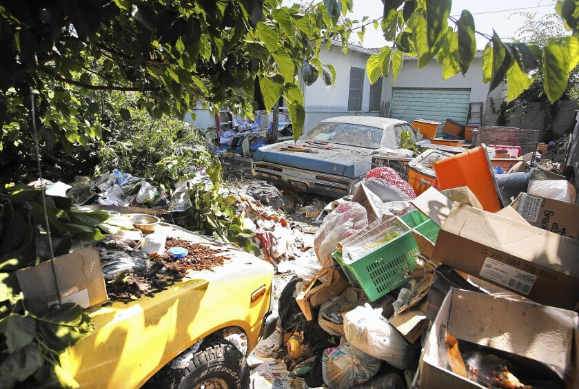 Former teacher dies in trash-clogged house