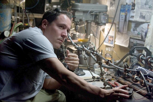"By Geoff Boucher, Los Angeles Times staff On the last day of postproduction on "" Iron Man 2,"" director Jon Favreau looked like a broken man. ""You don't want to shake hands, I'm sick,"" said the filmmaker whose superhero blockbuster just might be the movie that finishes as the highest-grossing release of 2010. But that possibility was far from Favreau's mind. ""I feel like I'm finishing this one the way El Cid finished the war, strapped onto his horse by his men and sent into battle dead."" One reason the battleground was so rough on Favreau is the secret weapon that made the first ""Iron Man"" such a nimble and memorable movie -- namely Robert Downey Jr. as the titular hero and Favreau's intense commitment to capture his singular spark on the screen. Like the first film, ""Iron Man 2"" was essentially rewritten over the entire filming process. The large set pieces, which required months of visual-effects work, were locked in and became the solid brick scenes of the film, but every bit of mortar between them was available for improvisation. Downey would try a dozen approaches and follow the one that worked. That meant a relentless need to patch, rework and rewire entire chunks of the film."