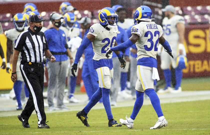Rams cornerback Jalen Ramsey and strong safety Jordan Fuller celebrate during a game against the Washington Football Team.
