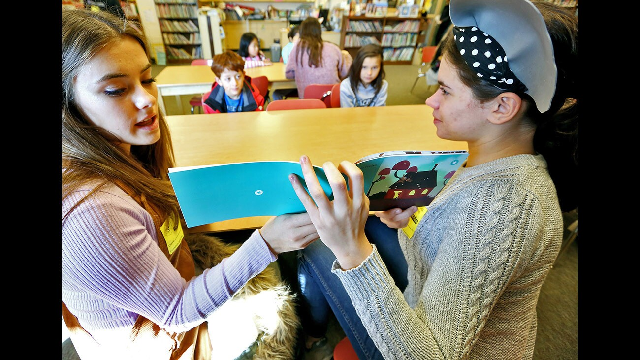Photo Gallery: La Cañada High students read French books they created in class