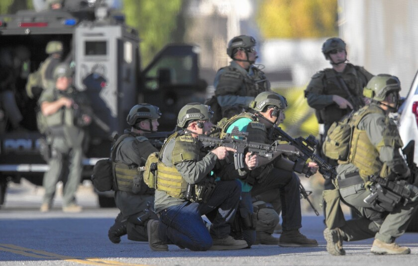 SWAT officers crouch on Richardson Street as they search for the San Bernardino shooters.