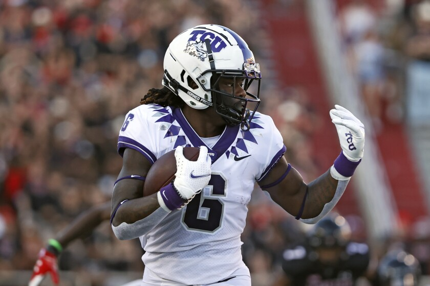 TCU's Zach Evans (6) runs with the ball during the first half of an NCAA college football game against Texas Tech, Saturday, Oct. 9, 2021, in Lubbock, Texas. (AP Photo/Brad Tollefson)