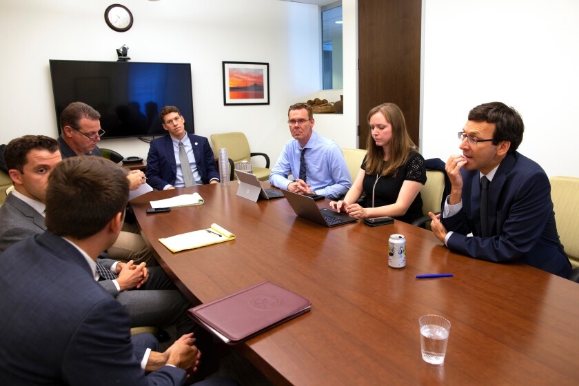 Ferguson confers with attorneys and other members of his staff on Sept. 19.