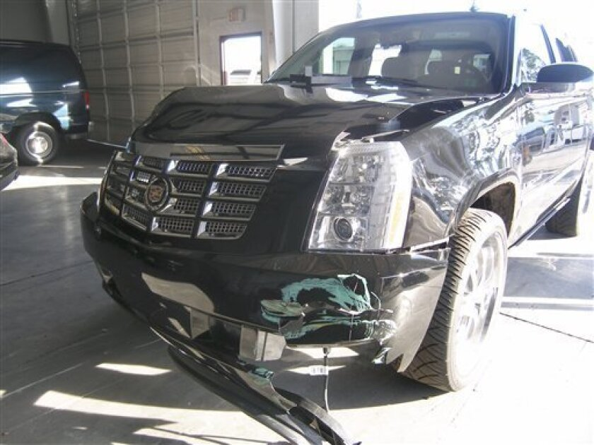 In this photo taken on Friday, Nov. 27, 2009 and released by the Florida Highway Patrol on Wednesday, Dec. 2, 2009, front end damage to Tigers Woods' vehicle is shown in Orlando, Fla. (AP Photo/Florida Highway Patrol)