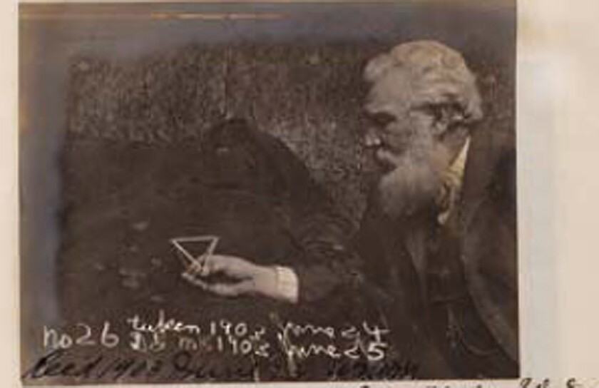 Alexander Graham Bell in 1903, holding a tetrahedron, the shape on which he hoped to base a kite-like flying machine. The photo is part of a research archive that was pulled from a historical artifacts auction Wednesday in Westlake Village as questions arose over its provenance.