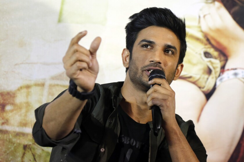"""In this Tuesday, May 30, 2017, file photo, Bollywood actor Sushant Singh Rajput speaks during a press conference to promote his upcoming movie """"Raabta"""" in Ahmadabad, India. The entertainment capital of India may be reeling under the coronavirus onslaught, but its celebrity inhabitants are being roiled by troubles of another kind. The recent suicide of Rajput, a young and popular movie actor in Mumbai has fueled a sustained reckoning over the privileges of the Bollywood elite, laying bare the simmering fault lines between the haves and the have-nots of the Hindi language movie industry. (AP Photo/Ajit Solanki, file)"""