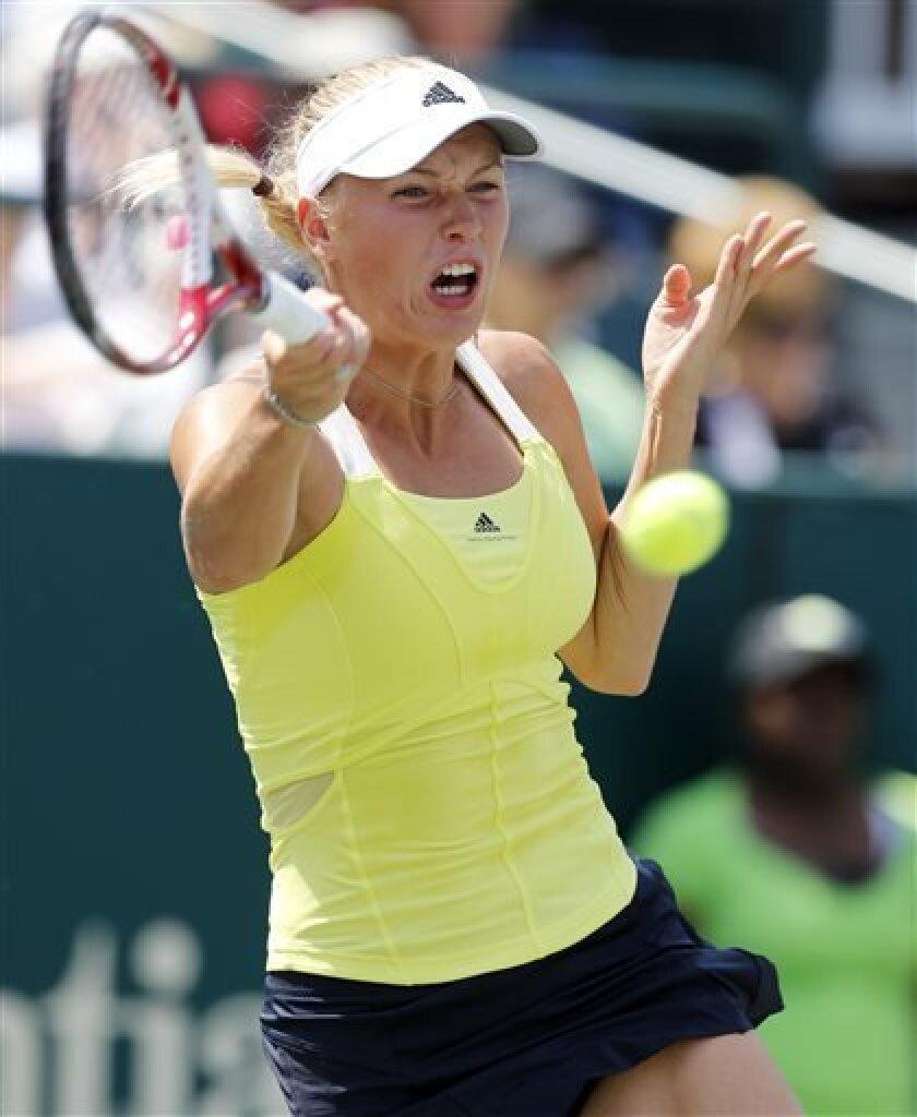 Caroline Wozniacki, of Denmark, returns to Silvia Soler-Espinosa, of Spain, at the Family Circle Cup tennis tournament in Charleston, S.C., Wednesday, April 3, 2013. (AP Photo/Mic Smith)