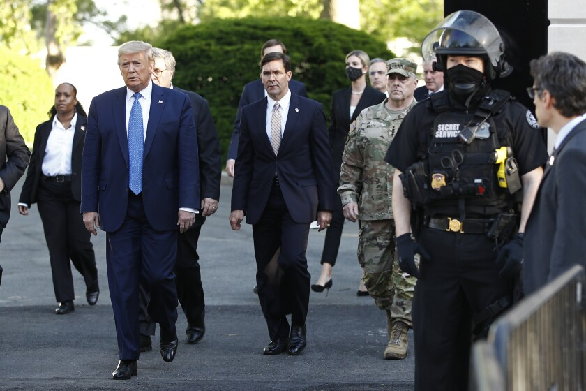 FILE - In this June 1, 2020, file photo President Donald Trump departs the White House to visit outside St. John's Church in Washington. (AP Photo/Patrick Semansky, File)