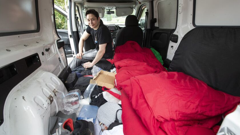 RESEDA, CA-JUNE 5, 2019: Alex Sage is photographed inside his former work van that he lived in from
