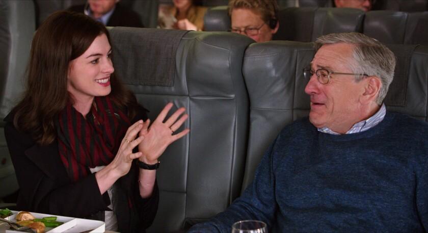 "Anne Hathaway as Jules Ostin and Robert De Niro as Ben Whittaker in ""The Intern."""