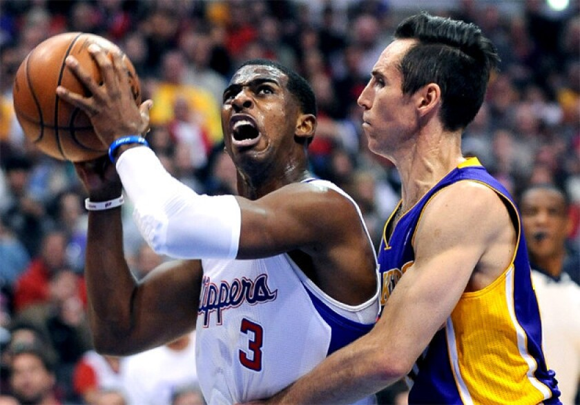 Clippers point guard Chris Paul drives to the basket against Lakers' Steve Nash.