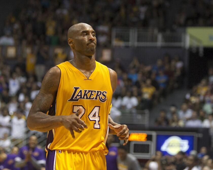 Kobe Bryant plays in an exhibition game against Utah on Oct. 6 in Honolulu.