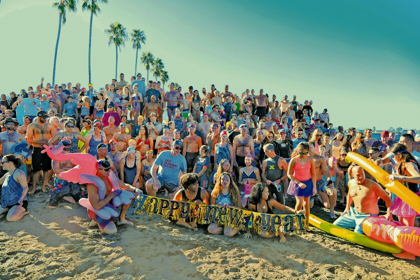 As is tradition, participants of the annual Polar Bear Plunge — held at La Jolla Shores on New Year's Day 2020 — gather for a large group photo.