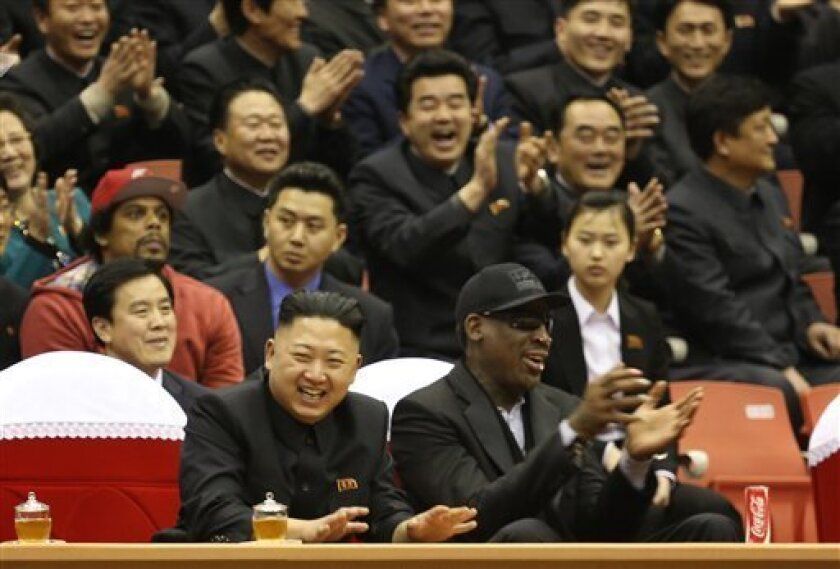 FILE - In this Feb. 28, 2013 file photo, North Korean leader Kim Jong Un, left, and former NBA star Dennis Rodman watch North Korean and U.S. players in an exhibition basketball game at an arena in Pyongyang, North Korea. Rodman showed Kim Jong Un some of the finer points of basketball, and the Nor
