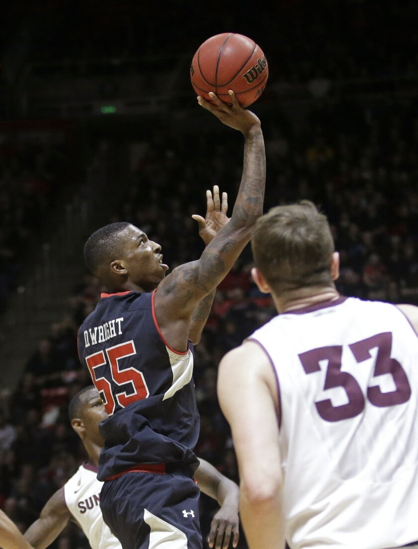 Utah guard Delon Wright (55) shoots as Arizona State's Bo Barnes (33) watches during the second half of an NCAA college basketball game Thursday, Feb. 26, 2015, in Salt Lake City. (AP photo/Rick Bowmer)
