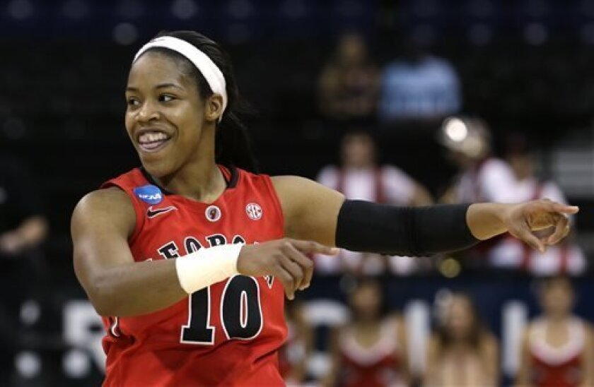 Georgia's Jasmine James celebrates in the final moments against Stanford in a regional semifinal in the NCAA women's college basketball tournament Saturday, March 30, 2013, in Spokane, Wash. Georgia won 61-59. (AP Photo/Elaine Thompson)