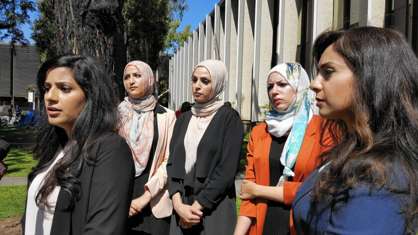 "Sara Farsakh, 29, left, stands with three other plaintiffs and one of their lawyers. The women are suing Urth Caffe in Laguna Beach for discrimination, alleging they were targeted in April for being ""visibly Muslim."""