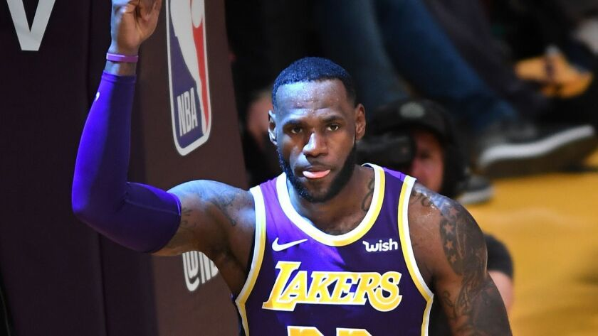 LOS ANGELES, CALIFORNIA MARCH 6, 2019-Lakers LeBron James celebrates his basket against the Nuggets