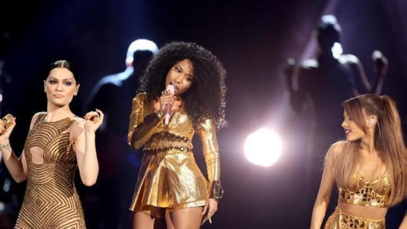 Jessie J, from left, Nicki Minaj and Ariana Grande perform at the 42nd annual American Music Awards at Nokia Theatre L.A. Live on Sunday, Nov. 23, 2014, in Los Angeles. (Photo by Matt Sayles/Invision/AP) (/ The Associated Press)