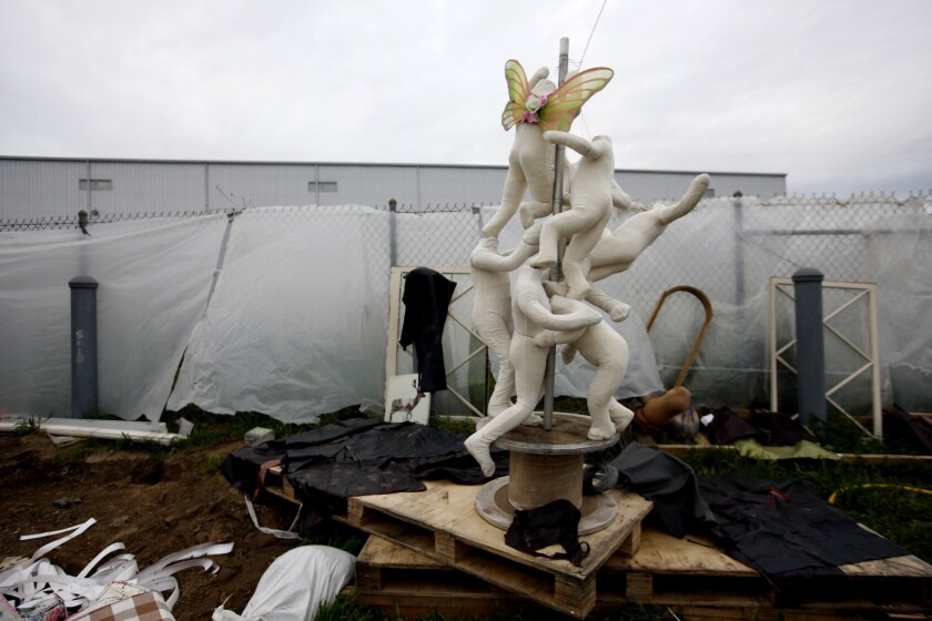 CHATSWORTH, CA MARCH 1, 2019: A sculpture in a homeless encampment between large satellite dishes