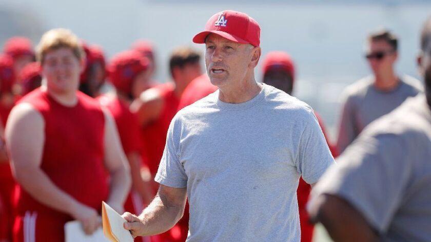 Los Alamitos High football coach Ray Fenton, seen Aug. 22, led his team to an upset win over Long Beach Poly last week.