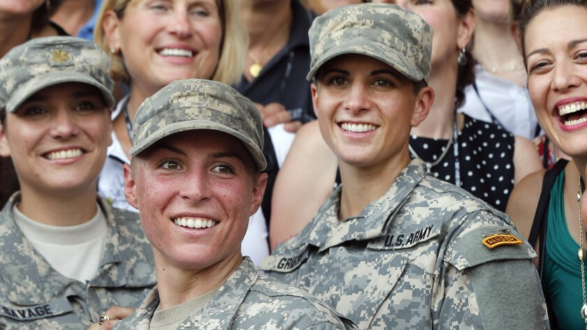 Army 1st Lt. Shaye Haver, second from left, and Capt. Kristen Griest, right, celebrate with other West Point alumnae after graduating from Ranger School on Aug. 21, 2015.
