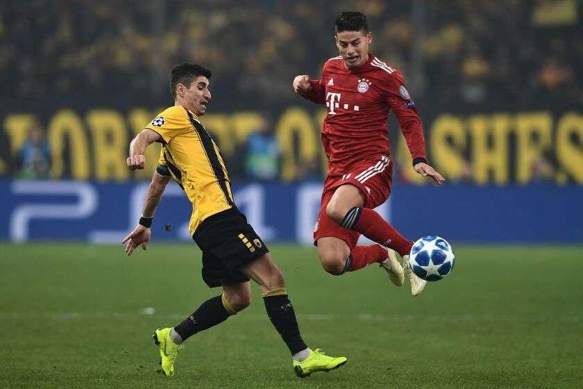 AEK's Greek midfielder Petros Mantalos (L) vies with Bayern Munich's Colombian midfielder James Rodriguez during the UEFA Champions League football match between AEK Athens FC and FC Bayern Munchen at the OACA Spyros Louis stadium in Athens on October 23, 2018.