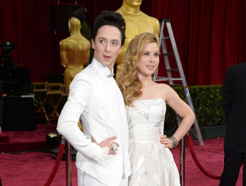 NBC figure-skating commentators Johnny Weir, left, and Tara Lipinski at this year's Oscars.
