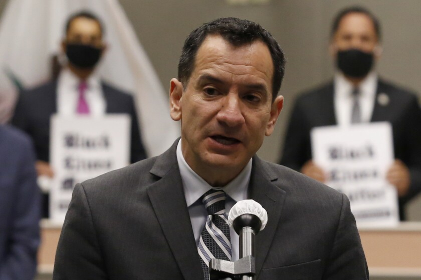 """Assembly Speaker Anthony Rendon, D-Lakewood, discusses his support to a proposed measure by Assemblyman Mike Gipson, D-Carson, to make it """"illegal to use the choke hold and carotid artery restrain tactics to forcibly detain a suspect,"""" during a news conference in Sacramento, Calif., Monday, June 8, 2020. The proposal appears to go beyond any other state's law and comes after a different restraint hold was used by Minneapolis police was blamed for the death of George Floyd. (AP Photo/Rich Pedroncelli)"""