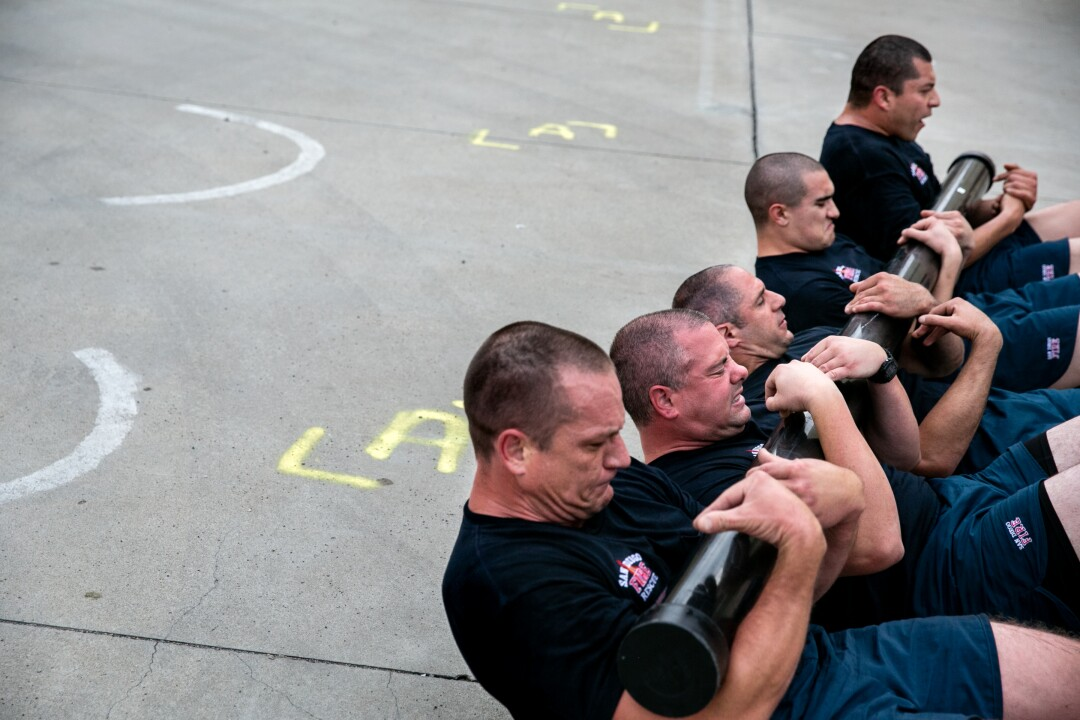 "Recruits take part in their ""Code 9,"" a grueling morning exercise that jump starts their day."