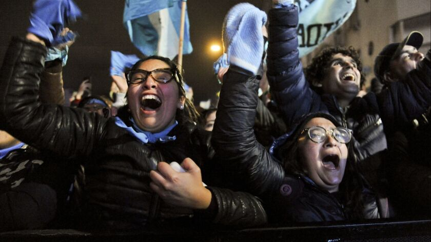 Demonstrators against decriminalizing abortion celebrate outside Congress in Buenos Aires, Argentina