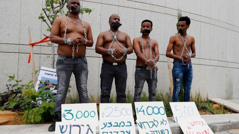 African migrants demonstrate in Tel Aviv against the Israeli government's policy to forcibly deport African refugees and asylum seekers to Rwanda and Uganda.